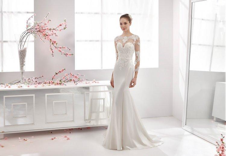 Закрытые свадебные платья с длинными рукавами: фото и советы